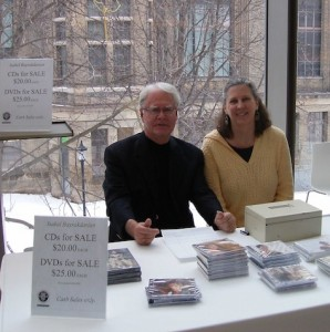 Susan and John Caldwell sell CDs in Koerner Hall